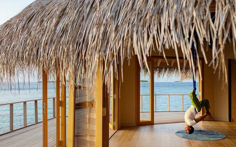 Man Doing Yoga Session at The Nautilus Maldives
